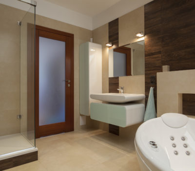Bathroom with bathtub and a glass shower