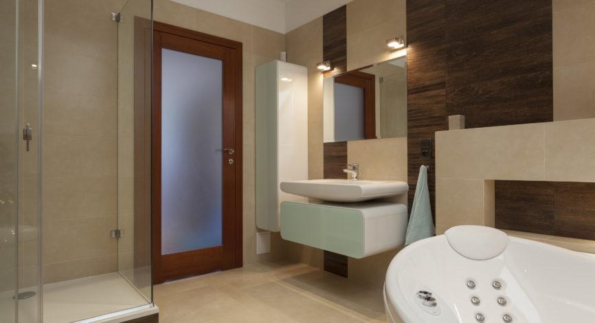 Bathroom with bathtub and a glass shower