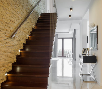 Classic style hallway with marble floor and wooden stairs